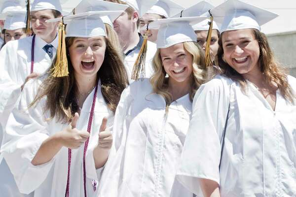 Lia Weinseiss, Allyndaire Whelehan and Skylar Telesco celebrate during the procession of the Joel Barlow High School graduation at the O'Neill Center at West Conn. Sunday, June 17, 2018