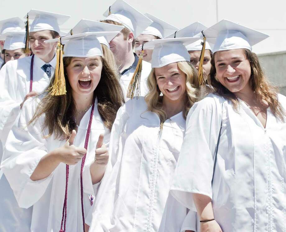 Lia Weinseiss, Allyndaire Whelehan and Skylar Telesco celebrate during the procession of the Joel Barlow High School graduation at the O'Neill Center at West Conn. Sunday, June 17, 2018 Photo: Scott Mullin, For Hearst Connecticut Media / The News-Times Freelance
