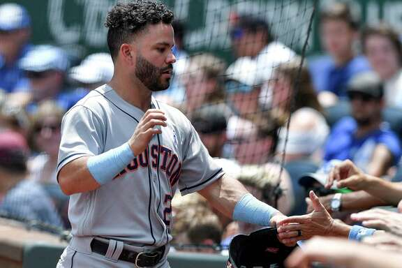 Houston Astros' Jose Altuve is greeted after scoring on a single by Yuli Gurriel in the first inning during against the Kansas City Royals on Sunday, June 17, 2018, at Kauffman Stadium in Kansas City, Mo.