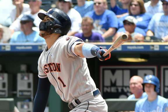 KANSAS CITY, MO - JUNE 17: Carlos Correa #1 of the Houston Astros hits an RBI single in the first inning against the Kansas City Royals at Kauffman Stadium on June 17, 2018 in Kansas City, Missouri. (Photo by Ed Zurga/Getty Images)