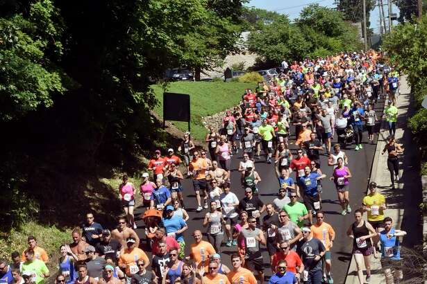 Branford, Connecticut- Sunday, June 17, 2018:  Participants race down Montowese Street during the 39th annual Branford Father's Day 5-Mile Run,  2 Mile Health Walk  and the 1-mile Kids Fun Run Sunday in Branford.