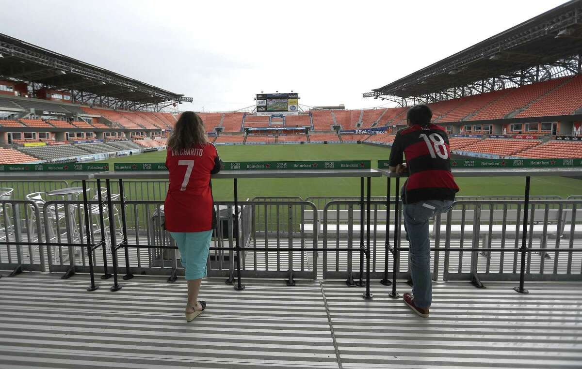 Fans watch Mexico and Germany face-off as the World Cup was live broadcast on jumbo screens during a Father?'s Day Free World Cup Watch Party at BBVA Compass Stadium, Sunday, June 17, 2018, in Houston. Houston-area families were invited to celebrate Father?'s Day as Mexico and Germany faced-off as the World Cup was live broadcast on jumbo screens at BBVA Compass Stadium. ( Karen Warren / Houston Chronicle )