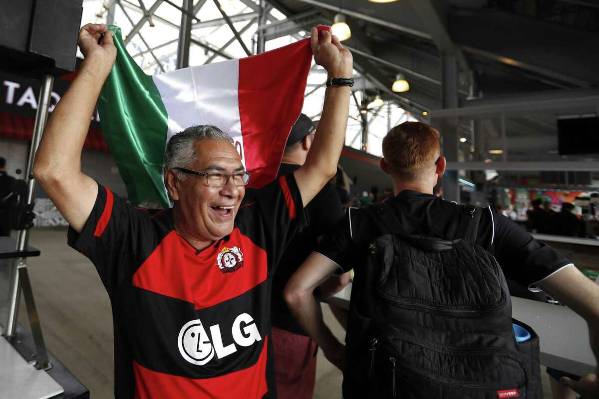 Ramon Villalpando celebrates after Mexico scored a goal as he and others watched Mexico and Germany face-off as the World Cup was live broadcast on jumbo screens during a Father?'s Day Free World Cup Watch Party at BBVA Compass Stadium, Sunday, June 17, 2018, in Houston. Houston-area families were invited to celebrate Father?'s Day as Mexico and Germany faced-off as the World Cup was live broadcast on jumbo screens at BBVA Compass Stadium. ( Karen Warren / Houston Chronicle )