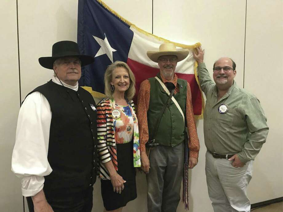 The Sons of the Republic of Texas gave a very interesting program about Texas History and their organization at the Conroe Noon Lion Club meeting last Wednesday. Pictured from left to right are John Thompson, Club President Helen Payne, John Meredith, and John Peyton.