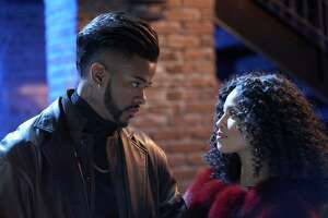 "This image released by Sony Pictures shows Trevor Jackson , left, and Lex Scott Davis in a scene from the film, ""Superfly."" (Quantrell D. Colbert/Sony Pictures via AP)"