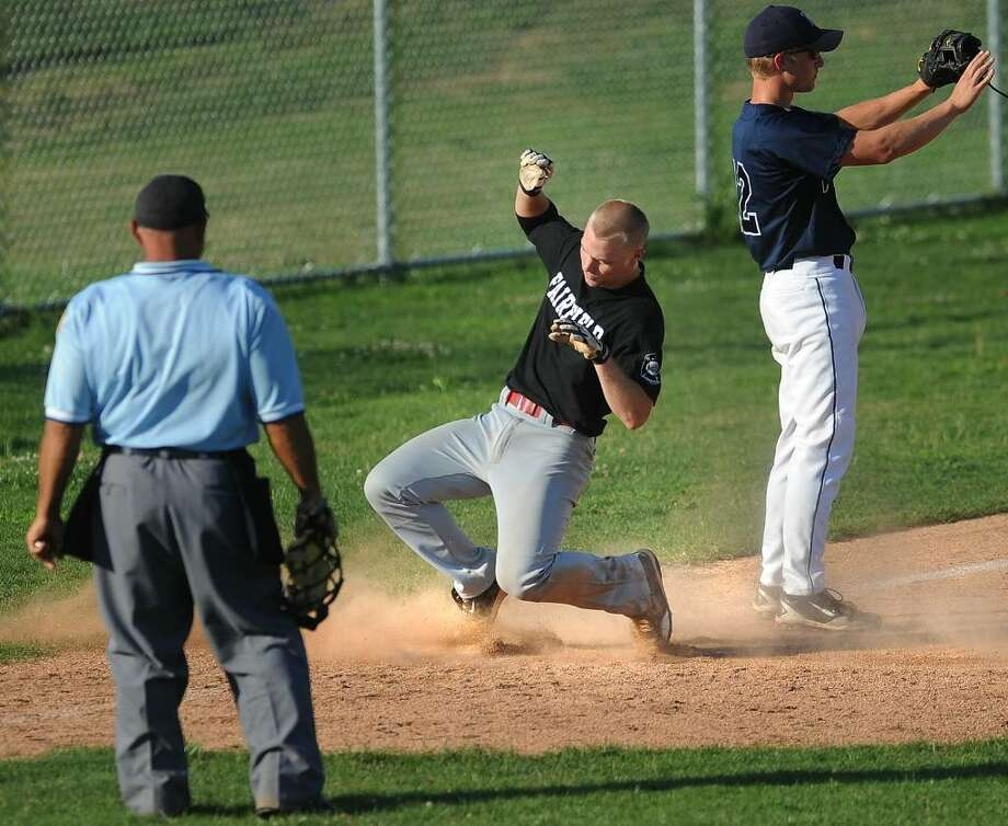 Fairfield's Tyler Colby slides safely into third base with a triple in the 3rd inning of Monday's American Legion matchup with Westport at Staples High School in Westport. Photo: Brian A. Pounds / Connecticut Post
