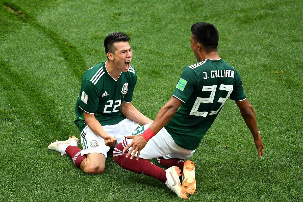 Hirving Lozano of Mexico celebrates with Jesus Gallardo by sliding on their knees after scoring his team's first goal during the 2018 FIFA World Cup Russia group F match between Germany and Mexico at Luzhniki Stadium on June 17, 2018 in Moscow, Russia. (Photo by Matthias Hangst/Getty Images) *** BESTPIX ***