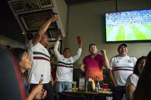 Edgar Oliver (left), Angel Godines, Mauro Hernandez and Gonzalo Tovar cheer Mexico's win over Germany.