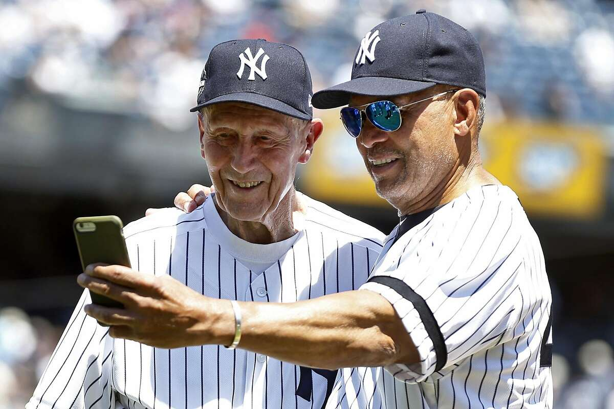 NEW YORK, NY - JUNE 17: Former players Dr.�Bobby Brown and Reggie Jackson of the New York Yankees take a selfie during the New York Yankees 72nd Old Timers Day game before the Yankees play against the Tampa Bay Rays at Yankee Stadium on June 17, 2018 in the Bronx borough of New York City. (Photo by Adam Hunger/Getty Images)