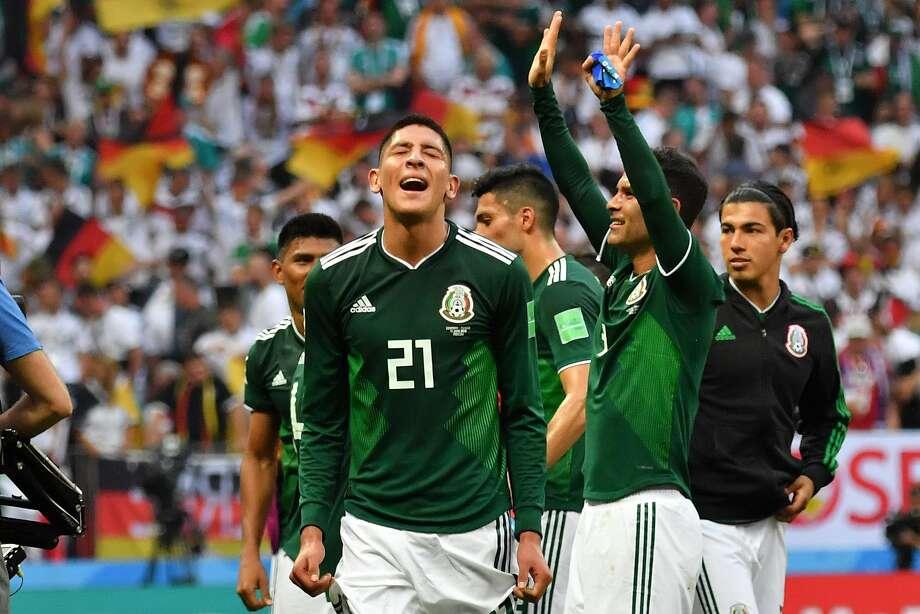0d292f720 TOPSHOT - Mexico s defender Edson Alvarez (L) and teammates celebrate their  1-0