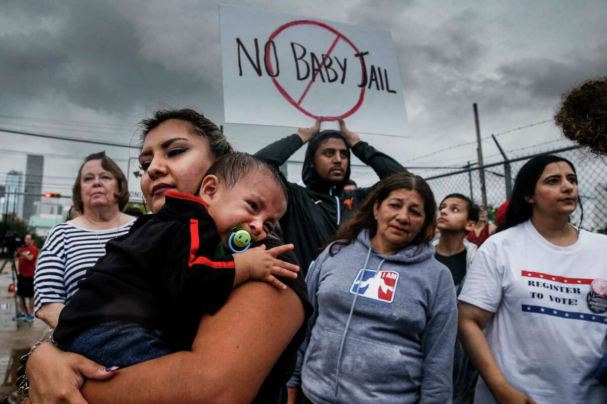 Aura Fernandez, left, holds her crying son, Leonardo Fernandez, 1, as protesters gather for a Families Belong Together prayer vigil outside a facility near downtown Houston that has been leased to house unaccompanied immigrant children Sunday, June 17, 2018.