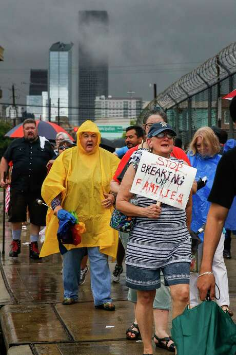 Protesters march during a Families Belong Together prayer vigil outside a facility near downtown Houston that has been leased to house unaccompanied immigrant children Sunday, June 17, 2018. Photo: Michael Ciaglo, Houston Chronicle / Michael Ciaglo