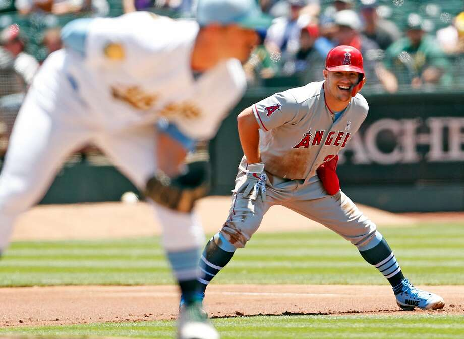 Los Angeles Angels' Mike Trout smiles while leading off first base against Oakland Athletics' starting pitcher Daniel Menhaden in 1st inning at Oakland Coliseum in Oakland, Calif. on Sunday, June17, 2018. Photo: Scott Strazzante / The Chronicle