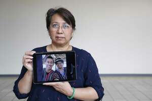 Vicky Nguyen holds a photo of her son, Will Nguyen, on June 17 in Houston. Nguyen is an American citizen who was among dozens of people arrested in Vietnam on June 10 during protests.