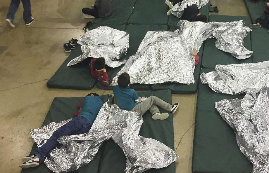 In this photo provided by U.S. Customs and Border Protection, people who've been taken into custody related to cases of illegal entry into the United States, rest in one of the cages at a facility in McAllen, Texas, Sunday, June 17, 2018. (U.S. Customs and Border Protection's Rio Grande Valley Sector via AP) Photo: Associated Press
