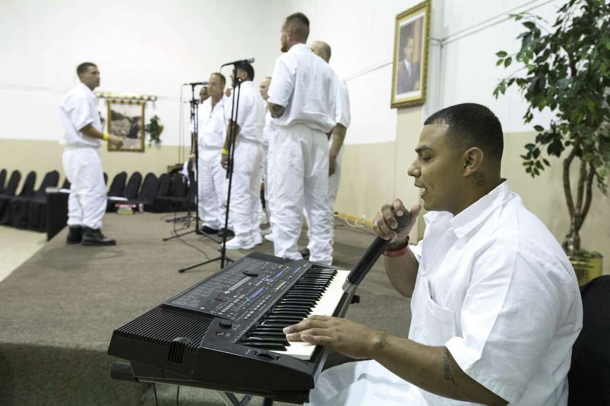 Maurice Castillo plays the keyboards as he plays with a combined choir made up of inmates from the Jester 3 and Vance Units peform at St. Paul Baptist Church for Father's Day on Sunday, June 17, 2018, in Houston. ( Brett Coomer / Houston Chronicle )
