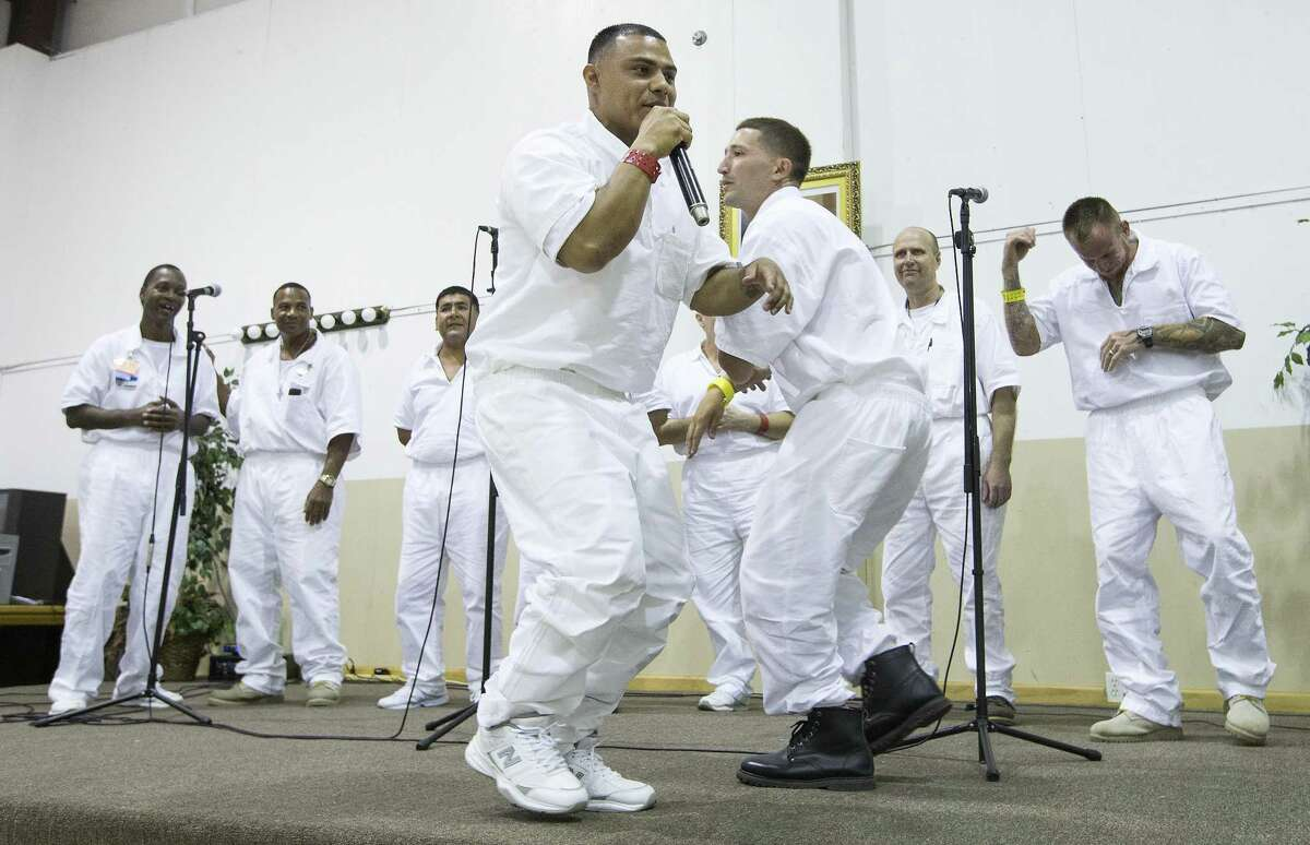 Maurice Castillo, left, and Preston Caroselli rap with a combined choir of inmates from the Jester 3 and Vance Units peform at St. Paul Baptist Church for Father's Day on Sunday, June 17, 2018, in Houston. ( Brett Coomer / Houston Chronicle )