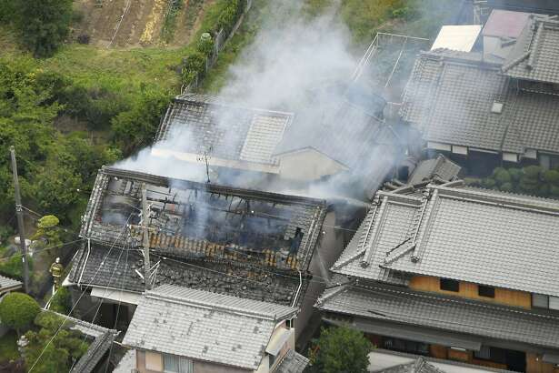 Smoke rises from a house blaze in Takatsuki, Osaka, following an earthquake Monday, June 18, 2018.  A strong earthquake shook the city of Osaka in western Japan on Monday morning, causing scattered damage including broken glass and partial building collapses. There were no immediate reports of injuries. (Kyodo News via AP)