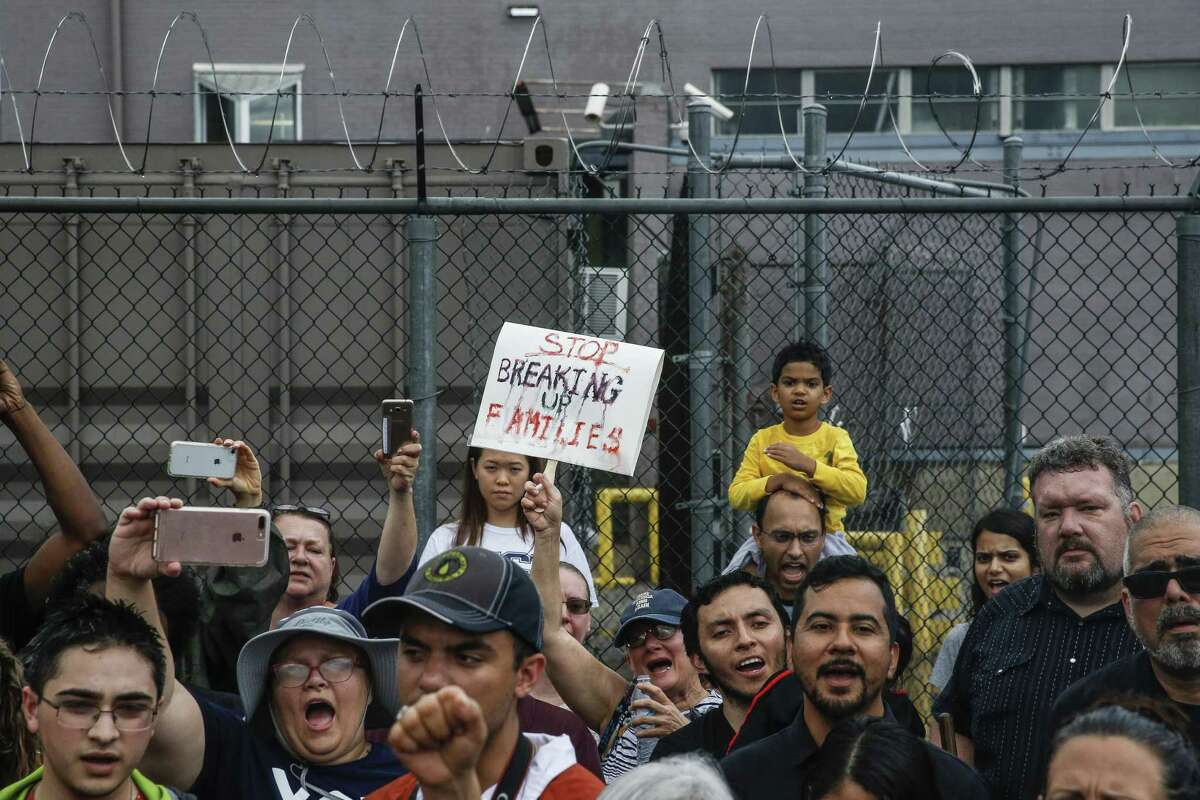 Protesters gather for a Families Belong Together prayer vigil outside a facility near downtown Houston that has been leased to house unaccompanied immigrant children Sunday, June 17, 2018. (Michael Ciaglo / Houston Chronicle)