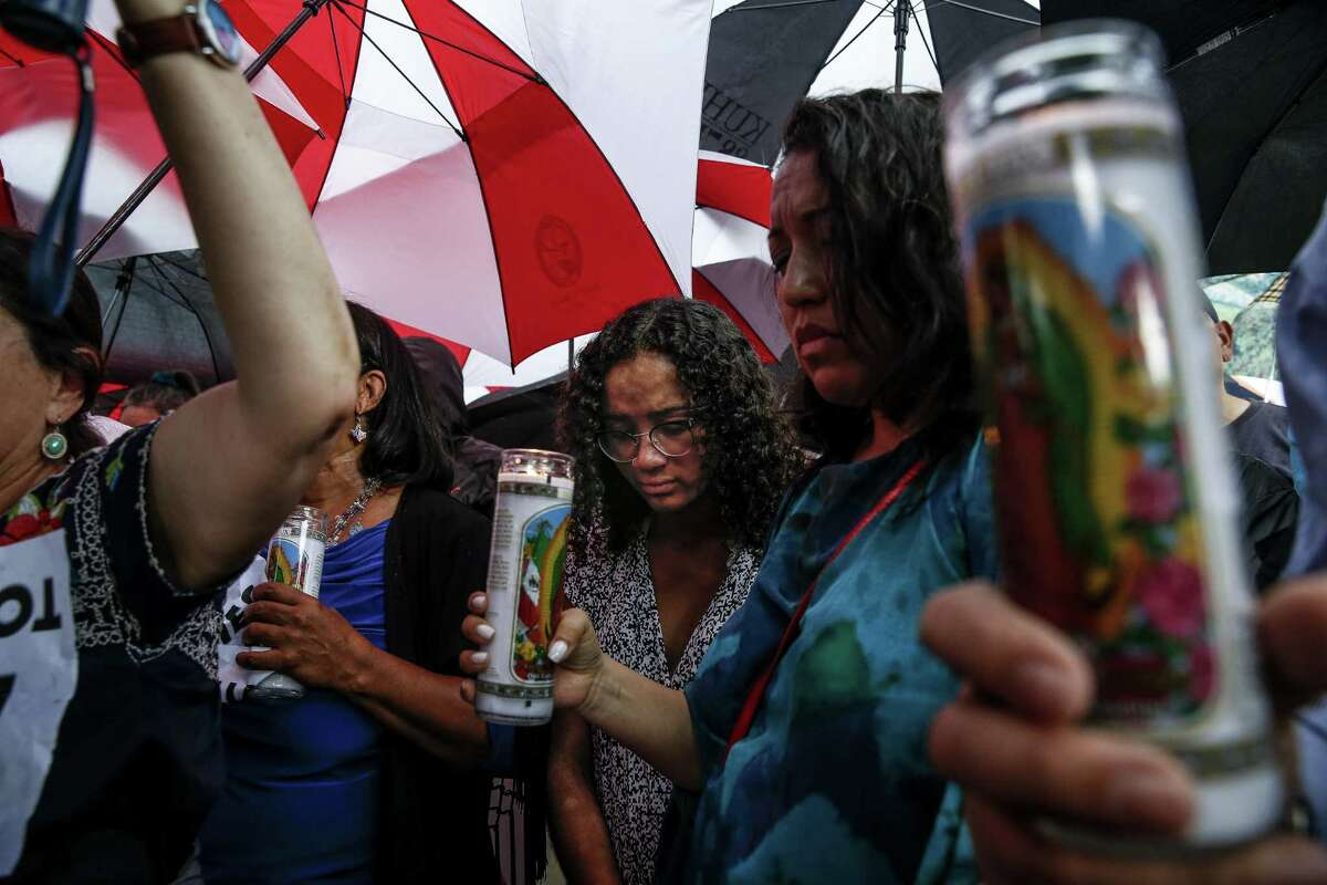 Viviana Collymore, 17, center, joins protesters as they gather for a Families Belong Together prayer vigil outside a facility near downtown Houston that has been leased to house unaccompanied immigrant children Sunday, June 17, 2018.