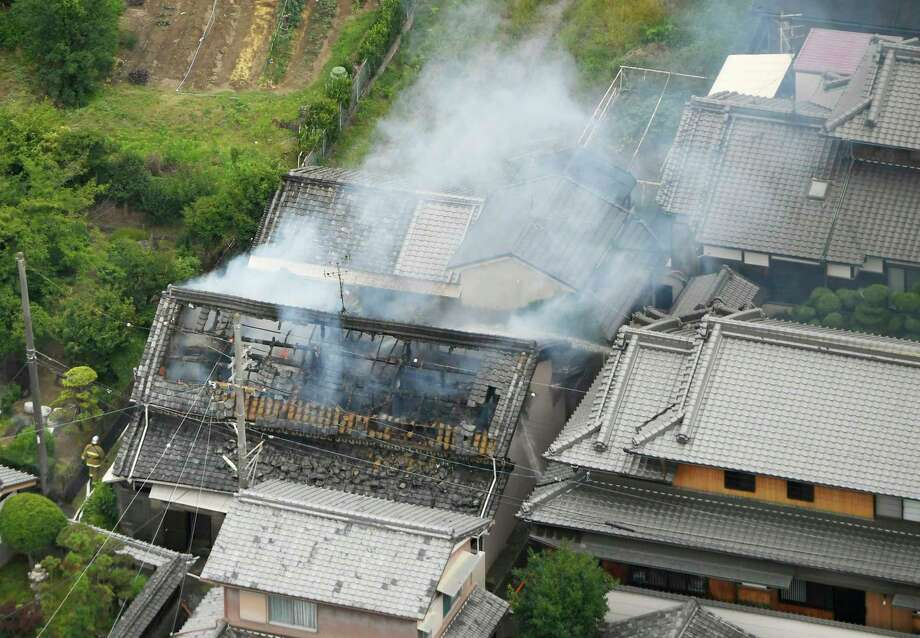 Smoke rises from a house blaze in Takatsuki, Osaka, following an earthquake Monday, June 18, 2018.  A strong earthquake shook the city of Osaka in western Japan on Monday morning, causing scattered damage including broken glass and partial building collapses. There were no immediate reports of injuries. (Kyodo News via AP) Photo: Yohei Nishimura, AP / Kyodo News