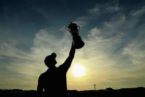Brooks Koepka celebrates with the campionship trophy after winning the 2018 U.S. Open at Shinnecock Hills on Sunday.