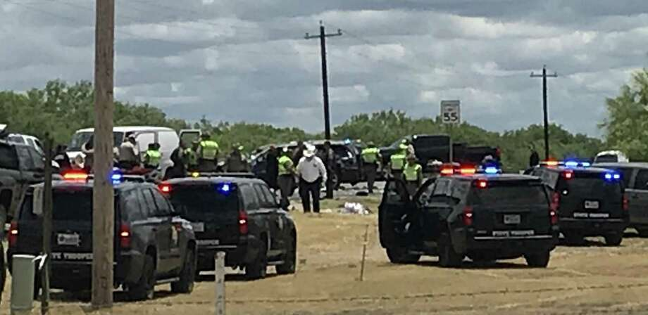 Law enforcement personnel work the scene of a rollover accident of an SUV that was carrying illegal immigrants along Texas Highway 85 in Big Wells, Texas, on Sunday, June 17, 2018. Five people died as a result of the crash. Photo: Courtesy Photo / SAN ANTONIO EXPRESS-NEWS