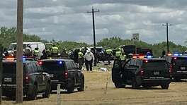 Law enforcement personnel work the scene of a rollover accident of an SUV that was carrying illegal immigrants along Texas Highway 85 in Big Wells, Texas, on Sunday, June 17, 2018. Five people died as a result of the crash.