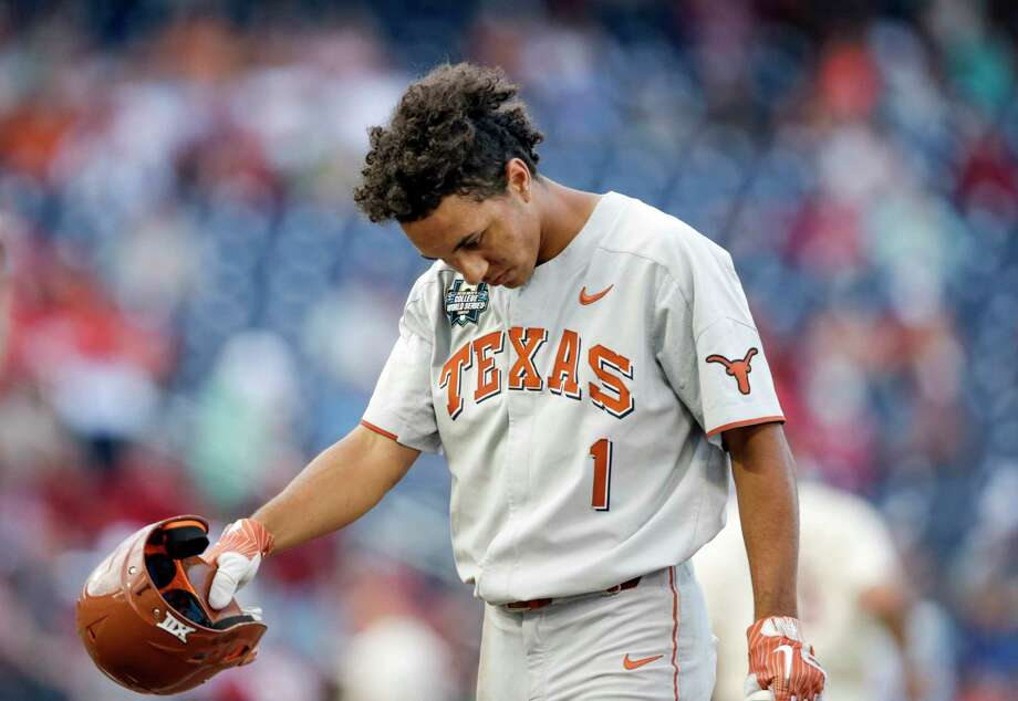 Texas' David Hamilton (1) reacts after striking out to end the inning, in the eighth inning with bases loaded during an NCAA College World Series baseball game against Arkansas in Omaha, Neb., Sunday, June 17, 2018. Arkansas won 11-5. (AP Photo/Nati Harnik) Photo: Nati Harnik, Associated Press / Copyright 2018 The Associated Press. All rights reserved.