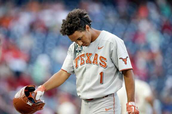 Texas' David Hamilton (1) reacts after striking out to end the inning, in the eighth inning with bases loaded during an NCAA College World Series baseball game against Arkansas in Omaha, Neb., Sunday, June 17, 2018. Arkansas won 11-5. (AP Photo/Nati Harnik)