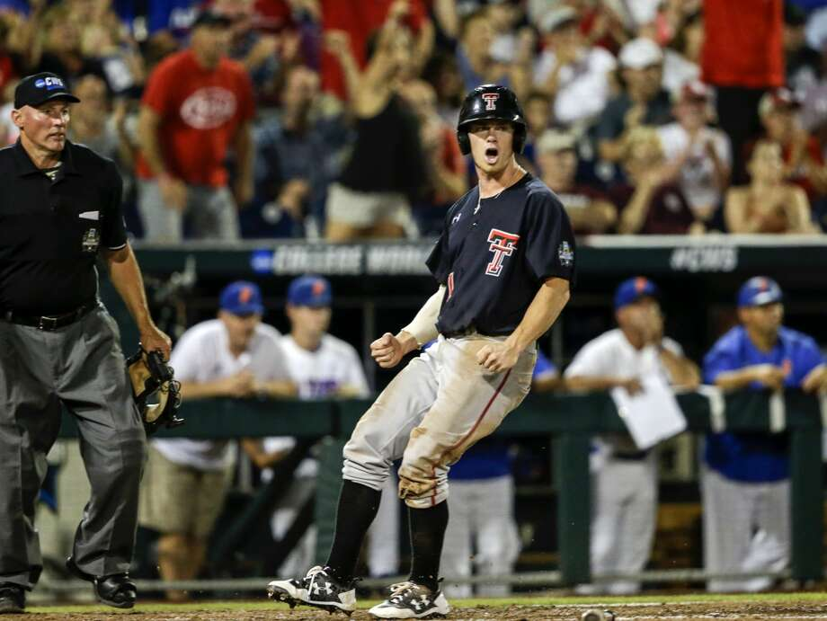 Texas Tech's Cody Farhat (1) reacts after scoring against Florida on a two-run single by Gabe Holt in the fifth inning of an NCAA College World Series baseball game in Omaha, Neb., Sunday, June 17, 2018. Braxton Fulford also scored on the play. (AP Photo/Nati Harnik) Photo: Nati Harnik/Associated Press