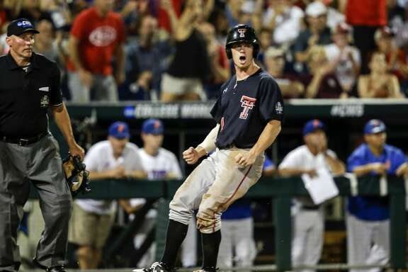 Texas Tech's Cody Farhat (1) reacts after scoring against Florida on a two-run single by Gabe Holt in the fifth inning of an NCAA College World Series baseball game in Omaha, Neb., Sunday, June 17, 2018. Braxton Fulford also scored on the play. (AP Photo/Nati Harnik)