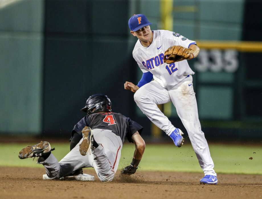 Texas Tech's Grant Little (4) steals second base against Florida second baseman Blake Reese (12) in the second inning of an NCAA College World Series baseball game in Omaha, Neb., Sunday, June 17, 2018. (AP Photo/Nati Harnik) Photo: Nati Harnik/Associated Press
