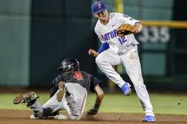 Texas Tech's Grant Little (4) steals second base against Florida second baseman Blake Reese (12) in the second inning of an NCAA College World Series baseball game in Omaha, Neb., Sunday, June 17, 2018. (AP Photo/Nati Harnik)