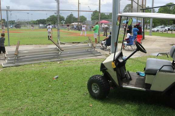 Spectators flipped the damaged bleachers upside down after this supply cart slammed into them during a  Sunday afternoon game. A little girl was in the cart when it plowed into the bleachers, injuring a 14-year-old girl from Conroe.