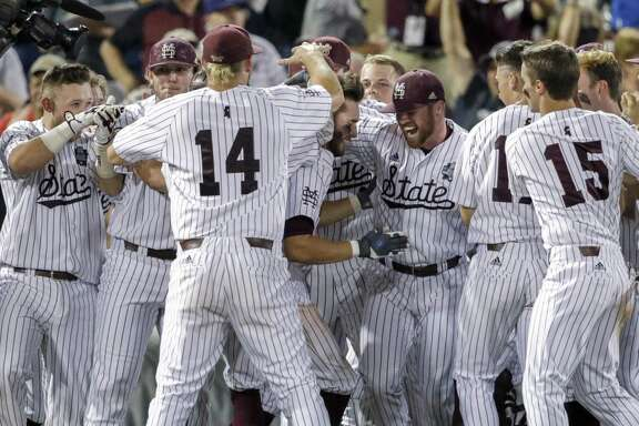 Mississippi State continued its dramatic run in the NCAA playoffs with a walkoff win over Washington, thanks to Luke Alexander, center, who hit a single that drove in Hunter Stovall in the ninth inning for Saturday night's 1-0 victory.