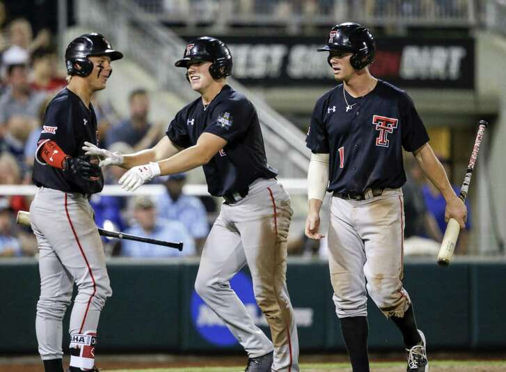 Texas Tech's Braxton Fulford, right, is congratulated by Brian Klein after scoring on Gabe Holt's two-run single Sunday night.