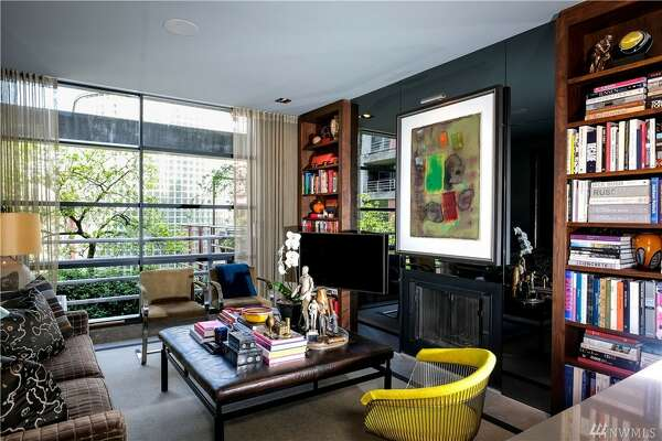 Across from the water, walkable to Pike's, downtown, and central business, this one bedroom condo has been remodeled to make the quirky most out of its square footage.