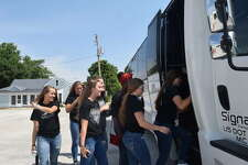 Players from of the West Central girls basketball team board the bus bound for Chicago Sunday to attend a WNBA game for the Chicago Sky.