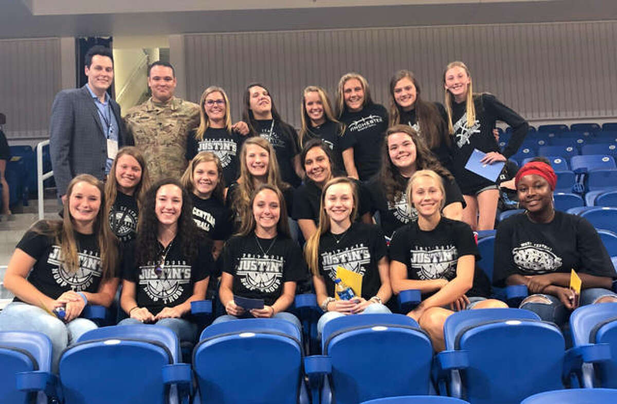 West Central girls basketball with coach Justin Vinyard and Director of ticket sales for Chicago Sky Jordan Nendelson.