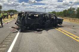 In this image tweeted by David Caltabiano of KABB/WOAI, a heavily damaged SUV is seen on Texas Highway 85 in Big Wells, Texas, after crashing while carrying more than a dozen people fleeing from Border Patrol agents on Sunday
