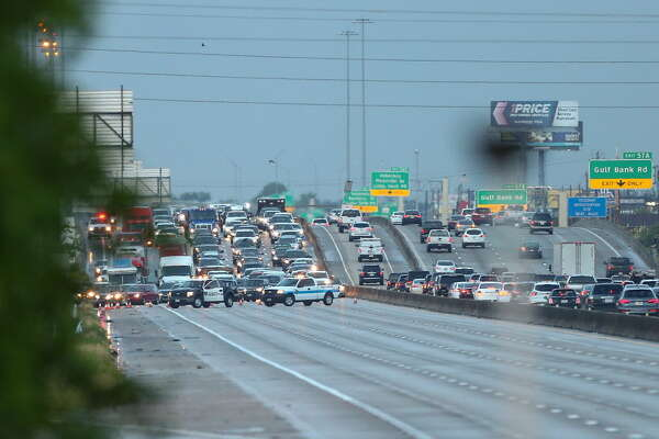 Motorists are diverted to the frontage road as Interstate 45 North remains closed following a deadly incident between West Mount Houston Road and West Road Monday, June 18, 2018, in Houston.