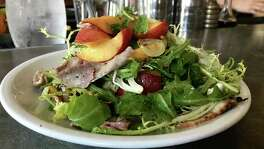 Texas peach and duck breast salad with pickled sweet peppers at Coltivare