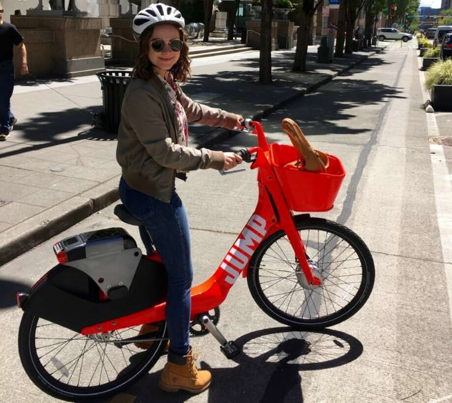 GeekWire's Monica Nickelsburg tested the only JUMP bike currently in Seattle. Photo: GeekWire Photo