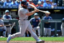 Houston Astros' Evan Gattis connects on an RBI single to score Yuli Gurriel in the eighth inning against the Kansas City Royals on Sunday, June 17, 2018, at Kauffman Stadium in Kansas City, Mo.