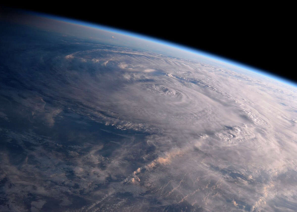 ADVANCE FOR USE TUESDAY, JUNE 19, 2018, AT 3:01 A.M. EDT AND THEREAFTER-FILE - This Saturday, Aug. 26, 2017 photo made available by NASA shows Hurricane Harvey over Texas, seen from the International Space Station.