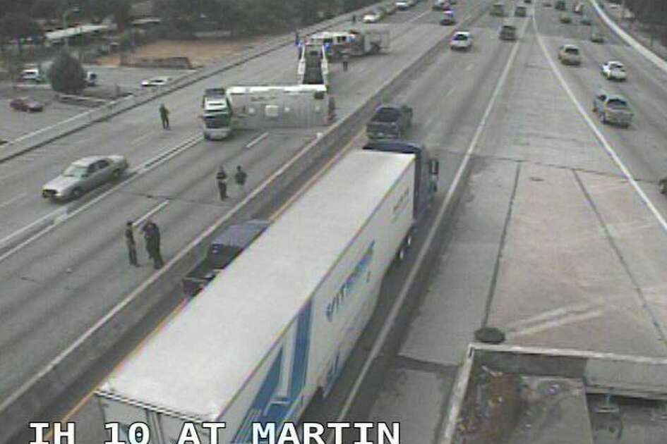 The crash was reported at 9:50 a.m. on I-10 and Martin Street. According to Texas Department of Transportation traffic cameras, the involved tractor-trailer is blocking three lanes, leaving only the rightmost lane open to traffic.