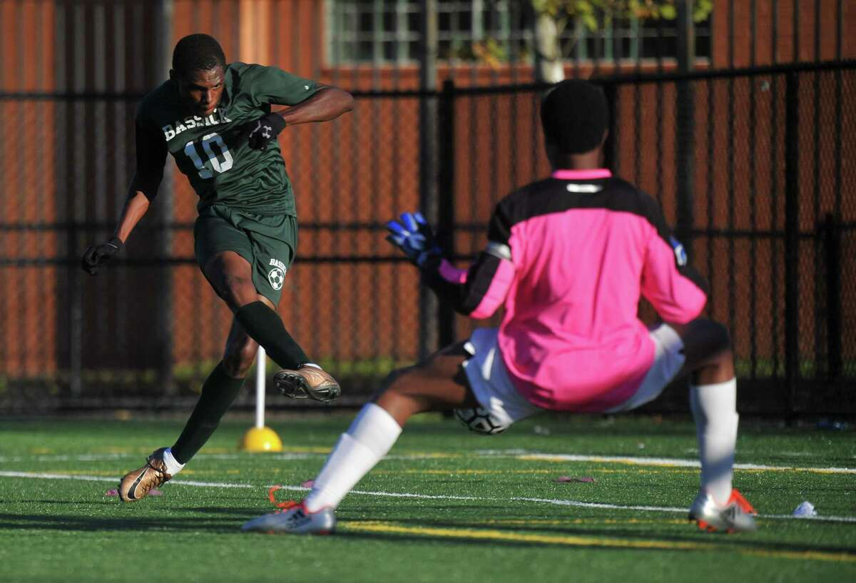 Joel Richards (10) of the Bassick Lions scores one of his three goals during a game against the Harding Presidents on October 11, 2016 at Luis Munoz Marin School in Bridgeport, Connecticut.