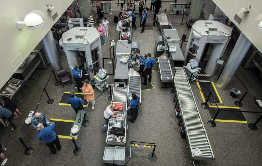 TSA workers do their security checks on passengers at the Albany International Airport Monday June 18, 2018 in Colonie, N.Y.   (Skip Dickstein/Times Union) Photo: SKIP DICKSTEIN, Albany Times Union / 20044132A