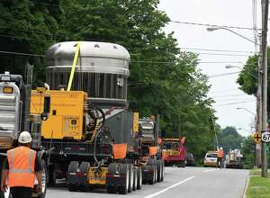 A nuclear material containment vessel is transported down Route 67 past the Saratoga County Municipal Buildings on its way to the Kenneth M. Kesselring nuclear training site on Monday, June 18, 2018, in Ballston Spa, N.Y. The container will be used to support the refueling and overhaul of a reactor. (Will Waldron/Times Union)